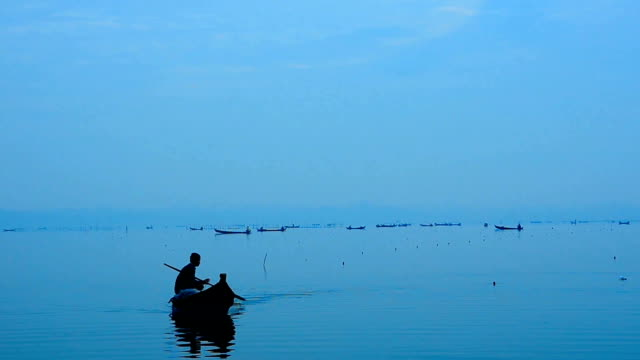 Fisherman working with peaceful twilight sunset at Amarapura, U-Bein bridge, Man video