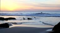 Fishermans at sea and big wave near seashore. video