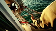 Fishermen at work, cleaning the nets on fishing boat video