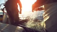 Fishermen at work, pulling the nets video