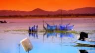 Fishermen fish trap device at lake video