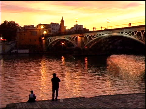 Fishing along the Guadalquivir River in Seville Spain video