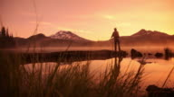 Fishing at sunrise, dolly movement video