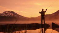 Fishing at sunrise video