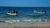 Fishing boat at beach and blue sky video