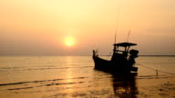 Fishing boat at beach and sunset video