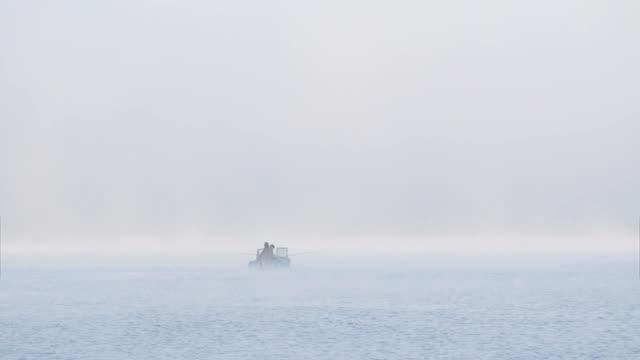 Fishing Boat at Sunrise Fog video