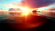 Fishing Boat At Sunset On Calm Sea video