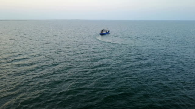 Fishing boat in the sea. aerial survey video