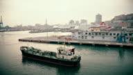 WS Fishing boat leaving a harbor in Genoa video