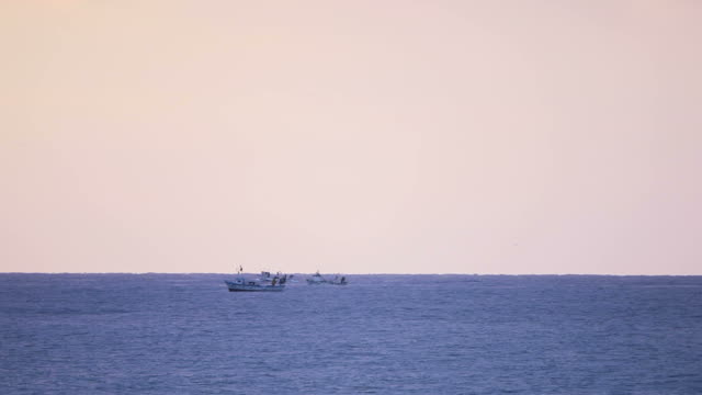 Fishing boats and sea video