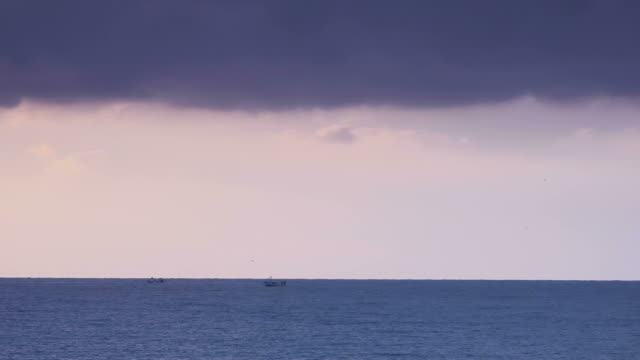 Fishing boats, ocean and storm video