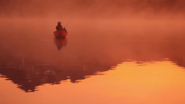 Fishing from canoe at sunrise video