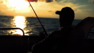 HD: Fishing From The Stern At Sunset video