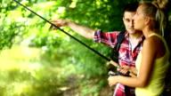 Fishing lesson at a lake. video