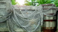 Fishing net on wooden storage. Back view. video
