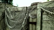 Fishing net on wooden storage - close up video