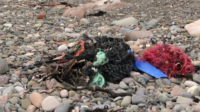 Fishing nets and debris washed up on a Scottish beach video