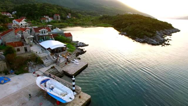 Fishing village on the shore of the peninsula Lushtitsa, in the video