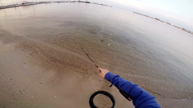 Fishing-Sea bass. Slow motion. POV video