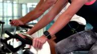 Fit athlete doing bike exercises video
