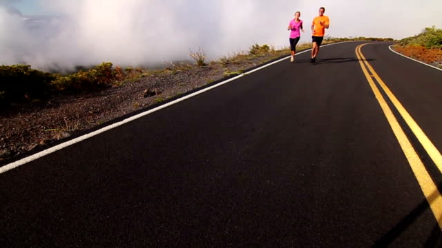 Fit Couple Running Above Clouds (Slow Motion) video