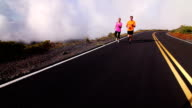 Fit Couple Running Above Clouds video