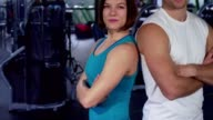 Fit couple shows thumbs up at the gym video
