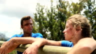 Fit man and woman interacting with each other during obstacle course video