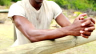 Fit man leaning on a hurdle during obstacle course video