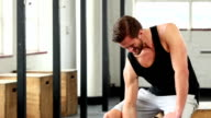 Fit man lifting heavy black dumbbell video