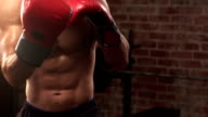 Fit man shadow boxing with gloves video