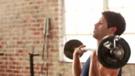 Fit man weightlifting and working out video