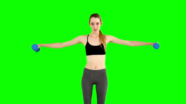 Fit model raising hand weights video