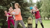 Fit Moms Doing Side to Side Squats video