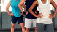 Fit people posing at camera in gym video