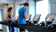 Fit people running on treadmills video