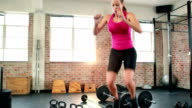 Fit woman doing box jumps video