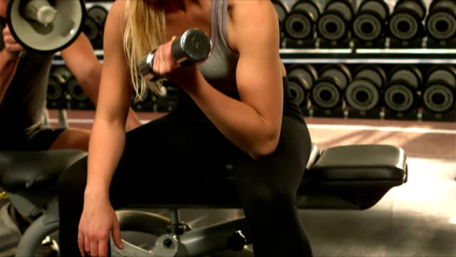 Fit woman excercising with weights video