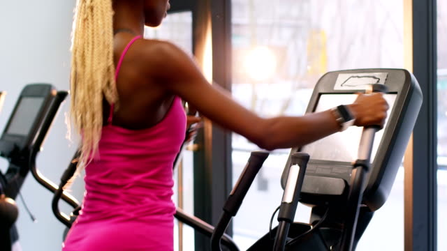 Fit woman exercising on cross trainer video