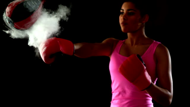 Fit woman in pink punching speed bag video