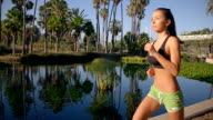 Fit Woman Jogging Though Park Slow-Motion video