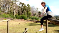 Fit woman jumping over the hurdles during obstacle course video