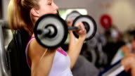 Fit woman lifting dumbbell video