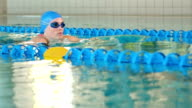 Fit woman swimming in the swimming pool video