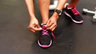 Fit woman tying his shoes video