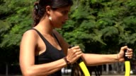 Fit Woman Using Exercise Machine video