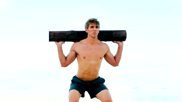 Fit Young Man Exercising on Beach. gym Work Out. Healthy Active Lifestyle Male Fitness Model. video
