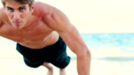 Fit Young Man Exercising on Beach. gym Work Out. Healthy Active Lifestyle. video