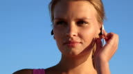 Fitness athletic girl using sport wireless headset while exercising outdoors video